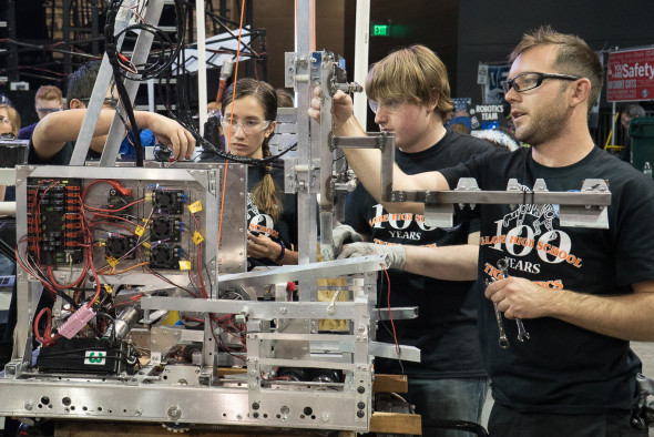 Globe TigeRobotics making some adjustments to their robot at Arizona West regional competition.